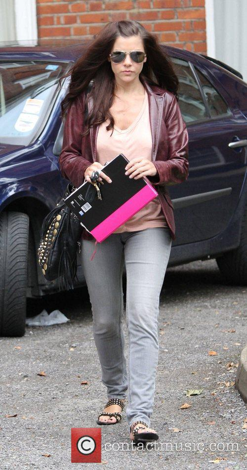 Imogen Thomas leaves her home in North London...