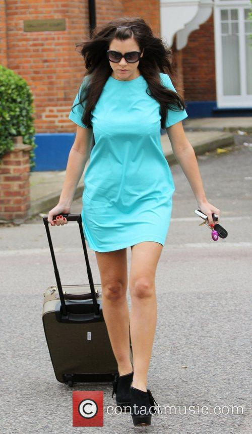 Imogen Thomas leaving her home, wearing a turquoise...