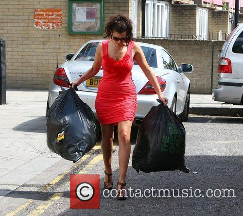 Imogen Thomas drops off some unwanted clothes at...