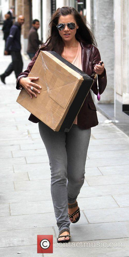 Imogen Thomas leaves publicist Max Clifford's office after...