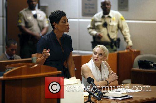 Lawyer Shawn Chapman Holley and Lindsay Lohan Lindsay...