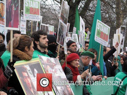 Hundreds of protesters gather outside the Iranian embassy...