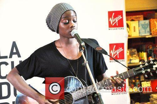 Performs a song showcase at Virgin Megastore on...