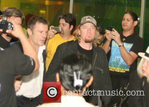 Iron Maiden guitarist Adrian Smith,  arrive at...