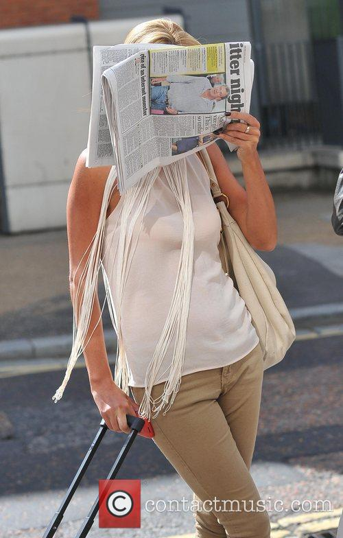 Helen Wood covers her face outside the ITV...