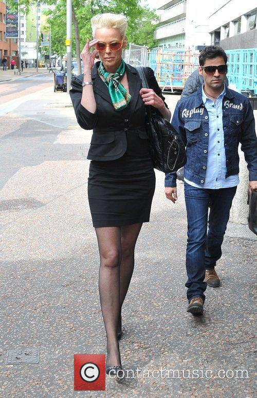 Arrives at the ITV studios ahead of her...