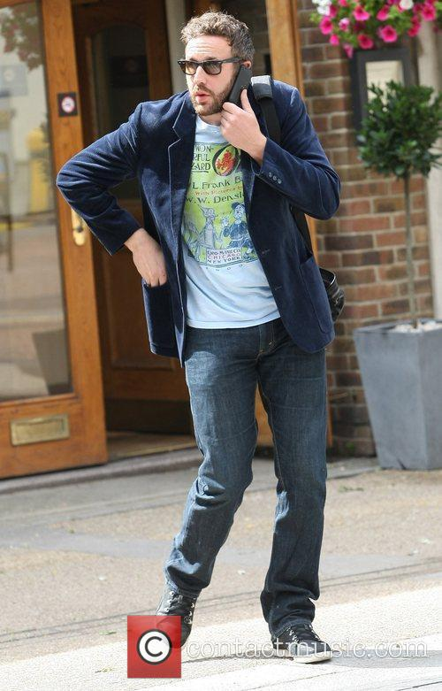 Chris O'Dowd walking through London after leaving the...