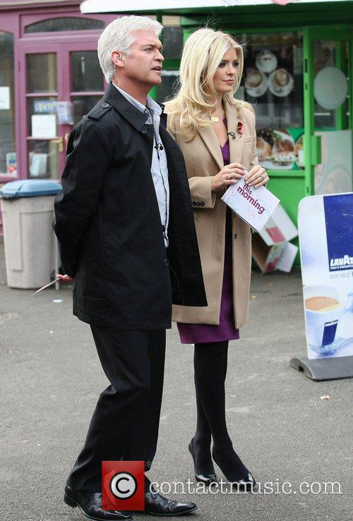 Presenters Holly Willoughby and Phillip Schofield filming outside...