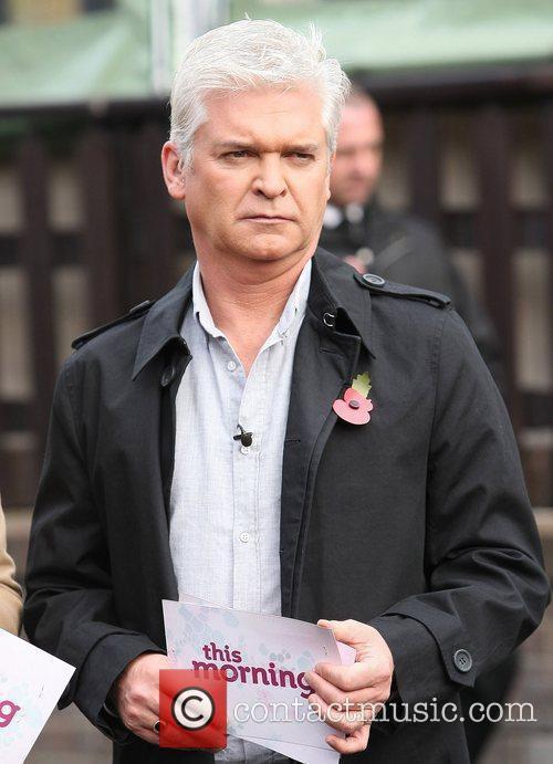 Presenters Phillip Schofield filming outside the ITV studios...