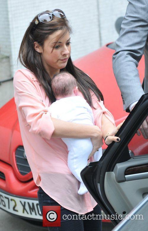Myleene Klass new baby Hero being held by...