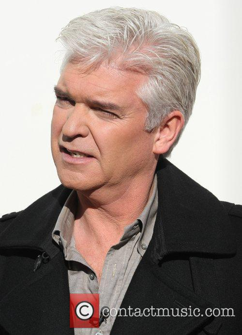 Phillip Schofield  filming outside the ITV studios...