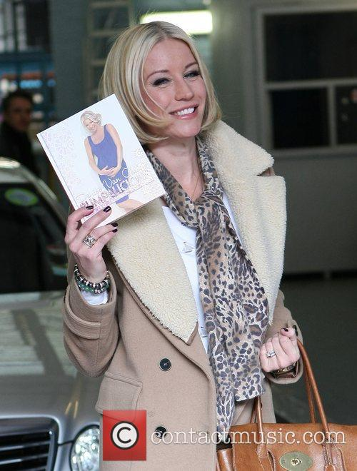 Denise van Outen holding a copy of her...