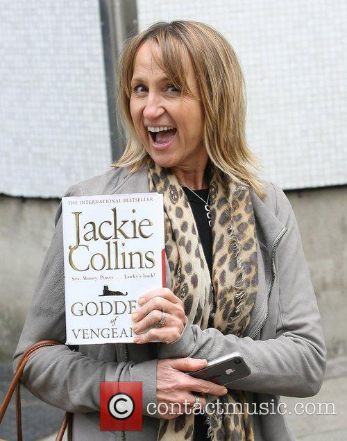 Carol McGiffin with a Jackie Collins novel Celebrities...