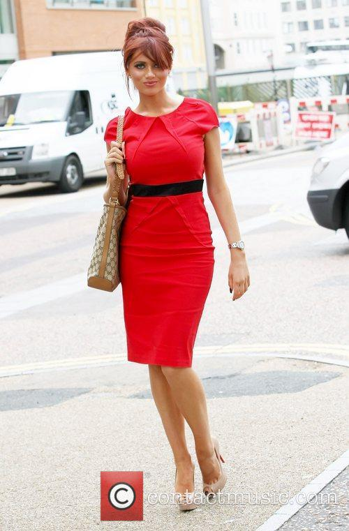 Amy Childs wearing a red dress outside the...