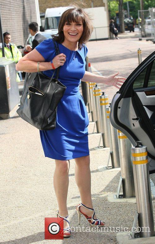 Outside the ITV studios, wearing a blue dress