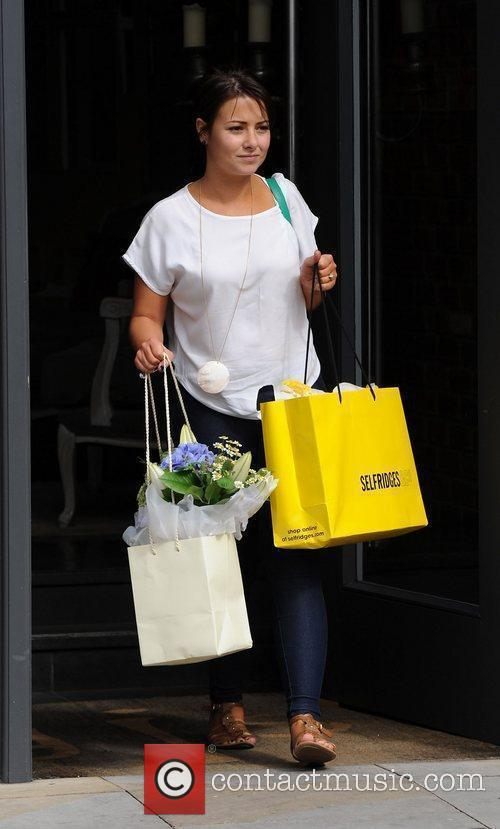 Lauren Shippey carrying gifts as she leaves Great...