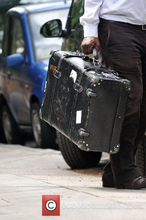Jamie Hince's suitcase being carried to his car...