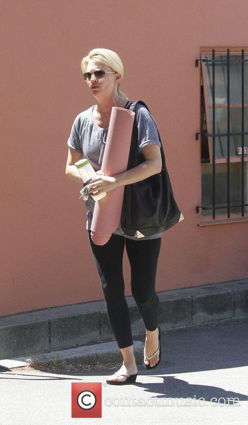 January Jones showing off her growing baby bump...