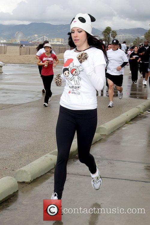 Atmosphere Celebrities participate in 'Relief Run' along Santa...