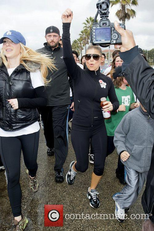 Fergie Celebrities participate in 'Relief Run' along Santa...