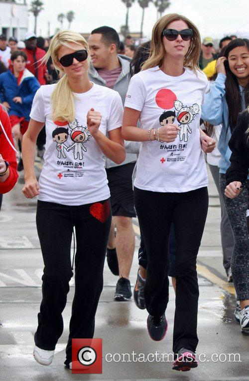 Paris and Nicky Hilton Celebrities participate in 'Relief...