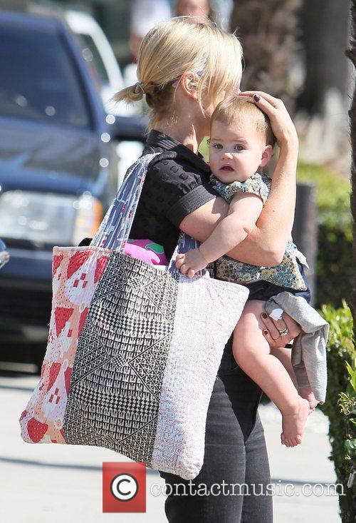 brady cunningham carries her daughter marlowe as 3581674