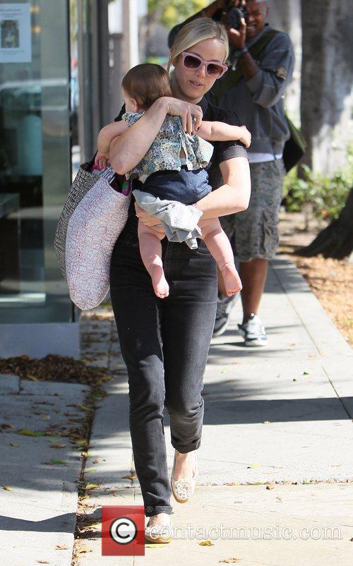brady cunningham carries her daughter marlowe as 3581677