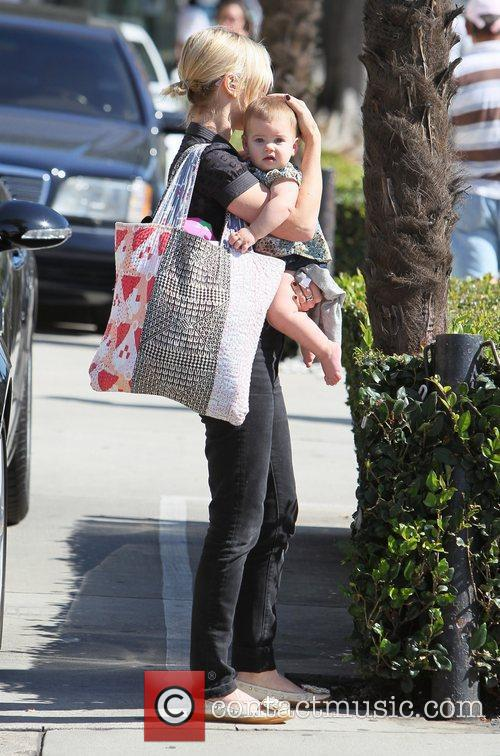 brady cunningham carries her daughter marlowe as 3581685