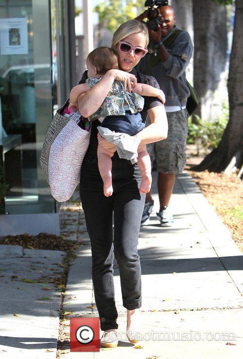 brady cunningham carries her daughter marlowe as 3581703