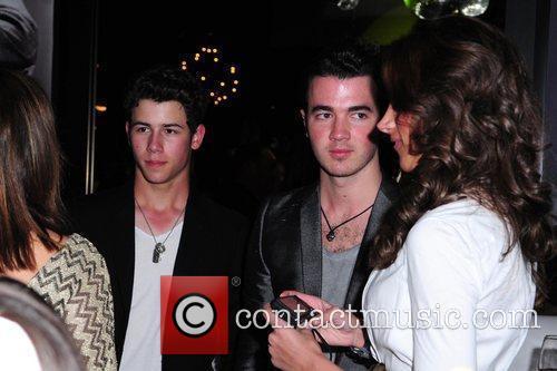 Nick, Kevin Jonas and Danielle Jonas Jason Taylor...