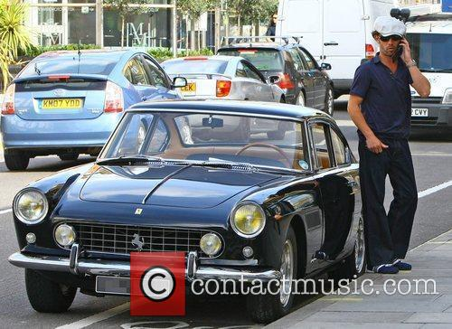 Getting out of his vintage Ferrari