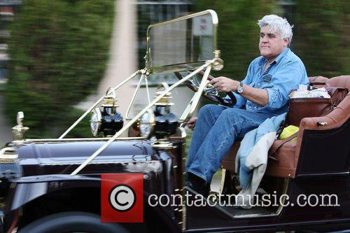 Jay Leno drives through Beverly Hills in a...