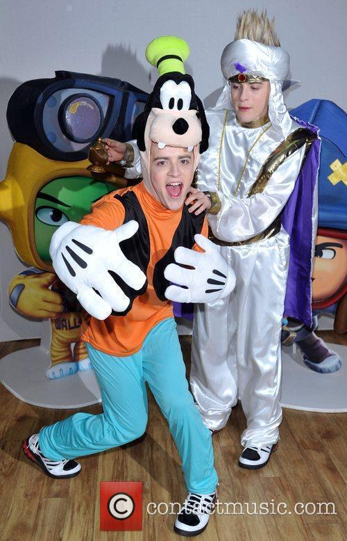 Jedward suit up as Goofy and Aladdin in...
