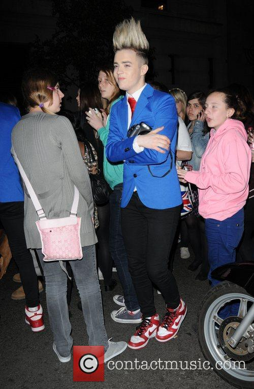 Edward Grimes of Jedward talking with fans outside...