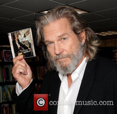 Signs copies of his debut album 'Jeff Bridges'...