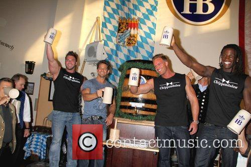 The Cippendales and Jeff Timmons tap the keg...