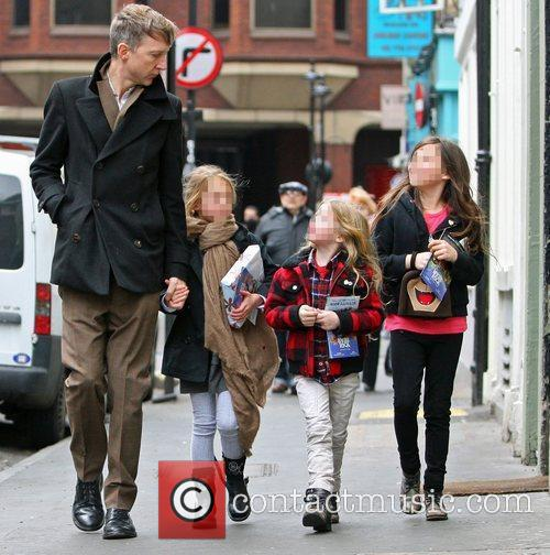 Jefferson Hack walking in London with his daughter...