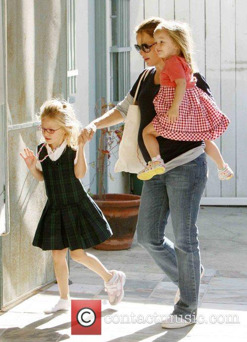 Out and about with her daughters Violet and...