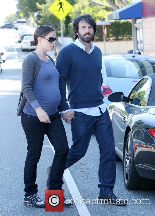 A heavily pregnant Jennifer Garner and husband Ben...