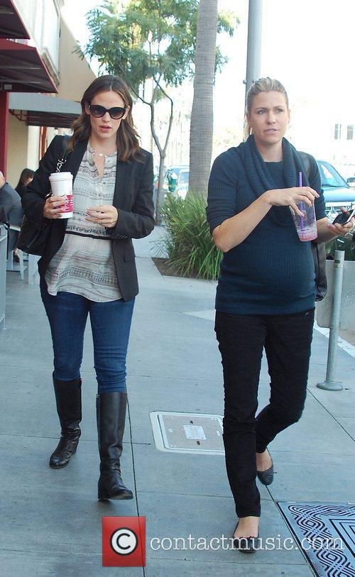 Pregnant Jennifer Garner and her friend who is...