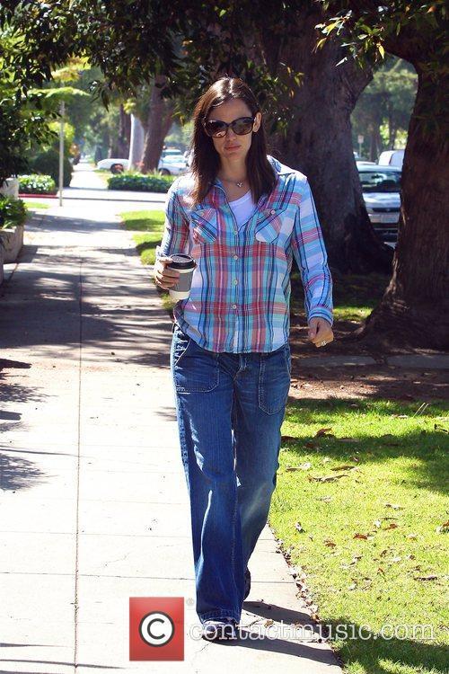 Jennifer Garner walks with a coffee in Santa...
