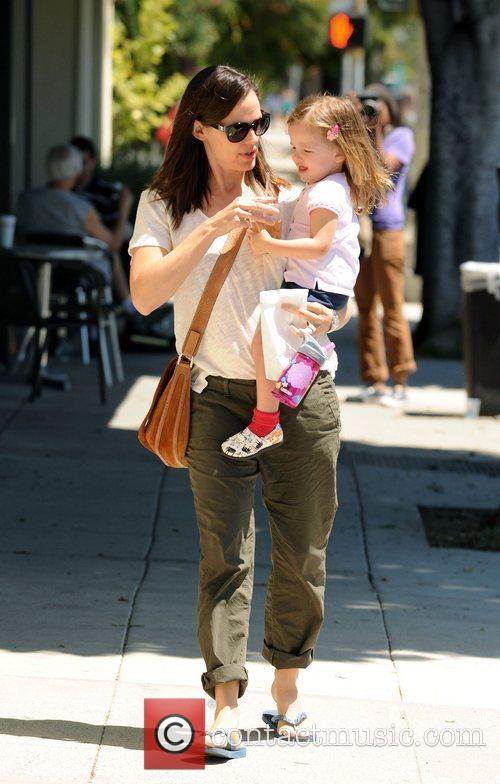 Carries her daughter Seraphina Affleck while out and...