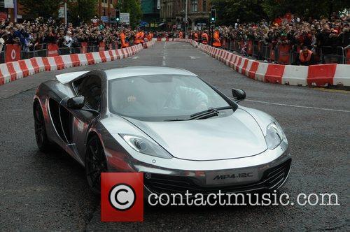 Jenson Button in a sports car Vodafone VIP...