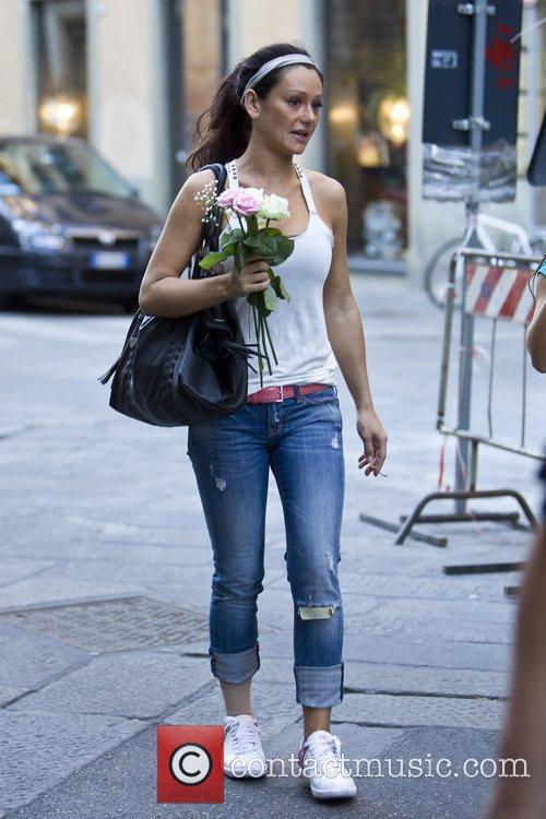 'Jersey Shore ' cast member holding flowers that...
