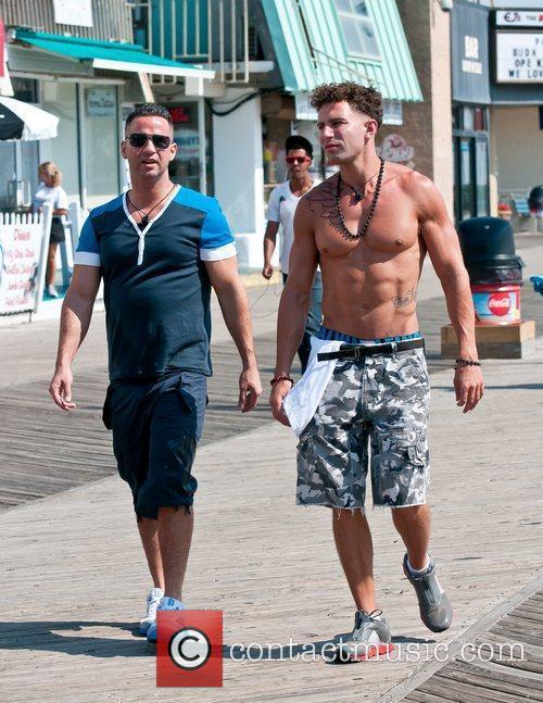 Walking along the boardwalk with a friend as...