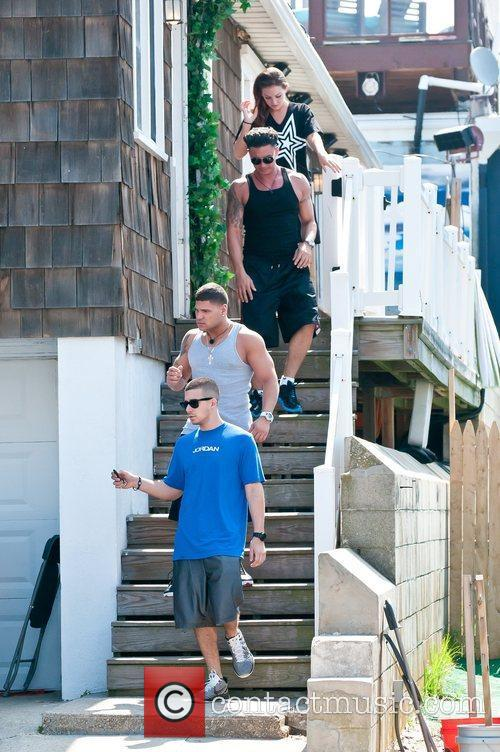 Paul delvecchio leaving their beach house during filming for Jersey house music