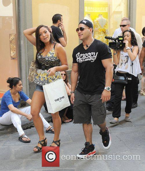 Jersey Shore cast members indulge in a spot...
