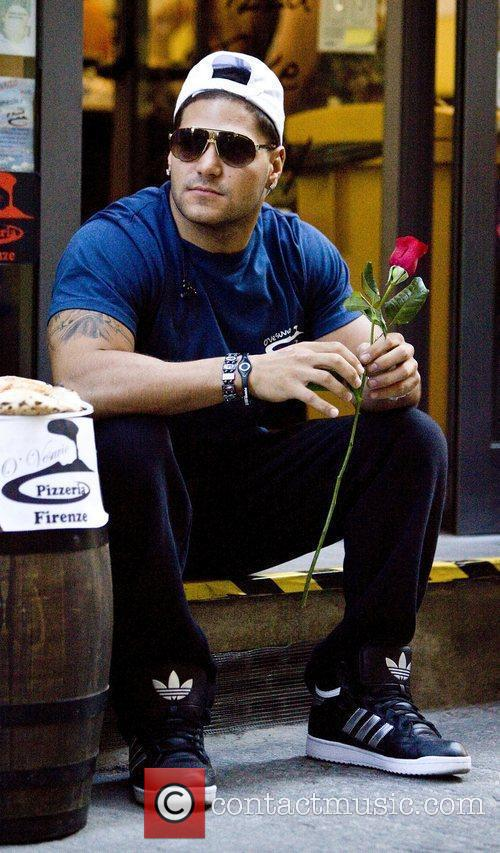 Ronnie Ortiz-Magro sits outside the O' Vesuvio Pizzeria...