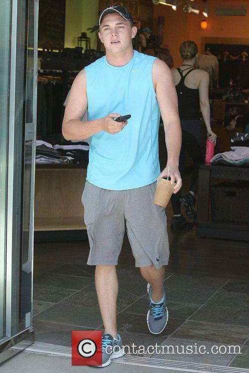 Jesse McCartney in summer shorts and blue vest...