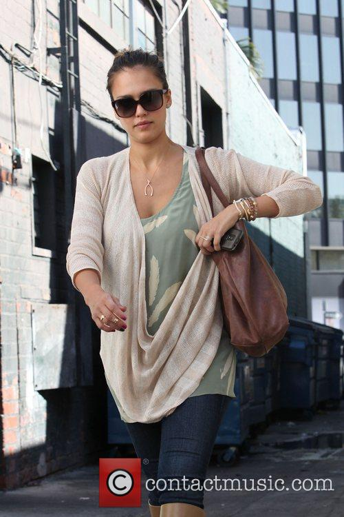 Jessica Alba out and about wearing a beige...